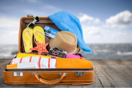packing suitcase: Beach, cruise, clothing. Stock Photo