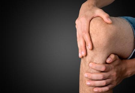tortured: Human Knee, Pain, Physical Injury. Stock Photo