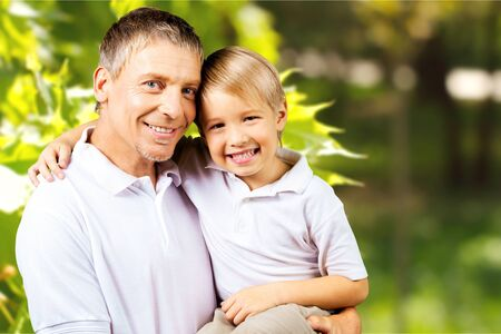 grand son: Grandfather with his grand son smiling