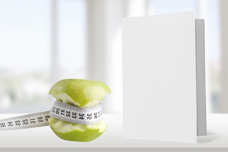 abstinence: Dieting, Tape Measure, Apple. Stock Photo