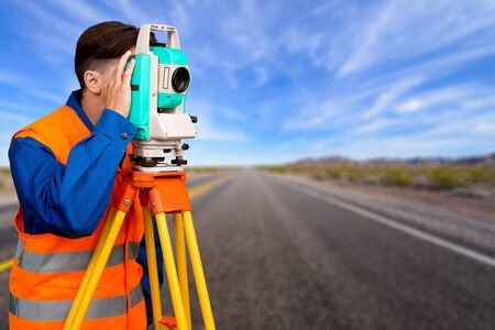 tachymeter: Surveyor, Land, Development. Stock Photo