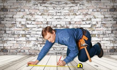 manual measuring instrument: Home Improvement, Construction Worker, Carpenter. Stock Photo
