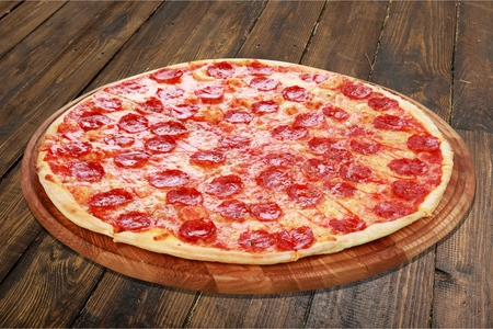 a portion: Pizza, Salami, Portion. Stock Photo