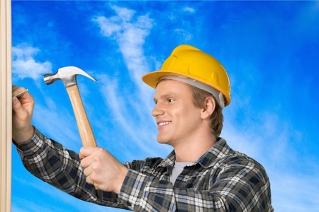 carpenter: Construction, Carpenter, Hammer. Stock Photo