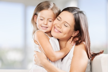 smiling mother: Mother, daughter, bio. Stock Photo
