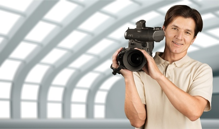home video camera: Camera Operator, Home Video Camera, Television Camera. Stock Photo