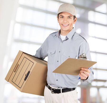 delivering: Delivering, Messenger, Delivery Person. Stock Photo