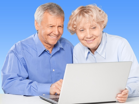 retirement community: Senior Adult, Couple, Computer. Stock Photo