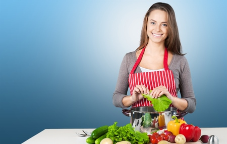 domestic kitchen: Cooking, Women, Domestic Kitchen. Stock Photo