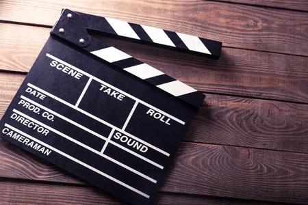 aplaudiendo: Cine, tablilla, director. Foto de archivo