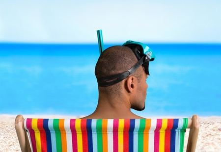 snorkelers: Snorkel relaxing at beach  Stock Photo