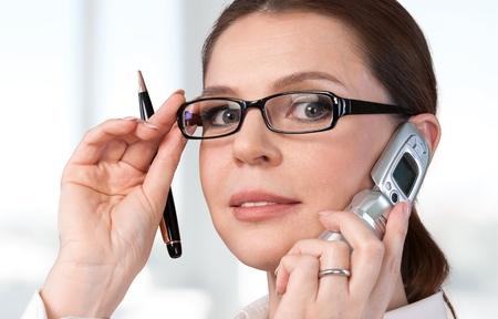 telephone: Women, Glasses, Telephone.