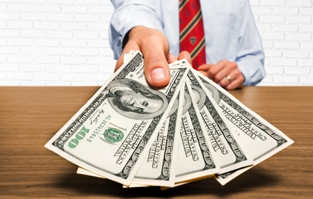 paying: Wages, Benefits, Paying. Stock Photo