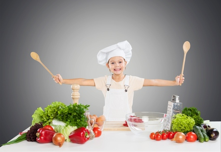 eating utensils: Kid, chef, fruit. Stock Photo