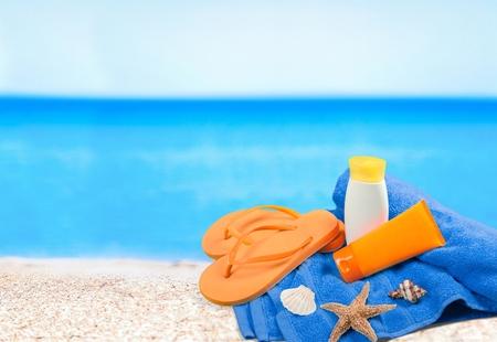 suntan lotion: Suntan Lotion, Flip-flop, Towel. Stock Photo
