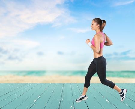 sideview: Run, runner, jogging. Stock Photo
