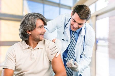 Inyectar, Vacunación, Gripe. Foto de archivo