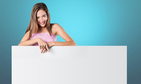 pointing at: Woman, billboard, blank.