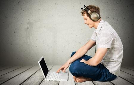webmail: Music, Men, Laptop. Stock Photo