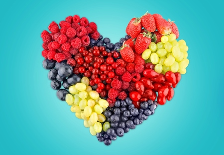 A Variety Of Summer Berries In The Shape Of Heart As A Symbol