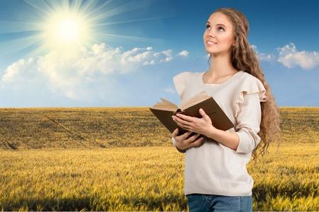 holding bible: Bible, Praying, Women. Stock Photo