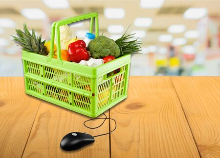 grocery baskets: Commerce, computer, ecommerce. Stock Photo