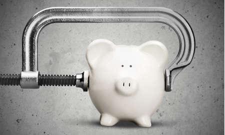 spendthrift: Cheap, Piggy Bank, Recession. Stock Photo