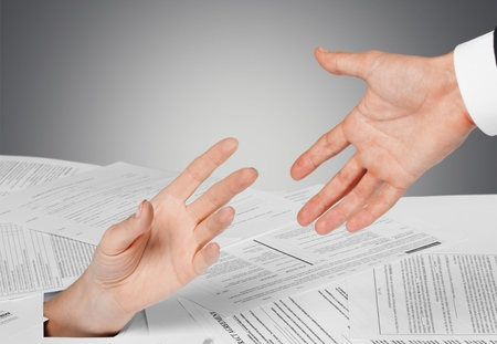 finance a helping hand confusion: Finance, Tax, Paperwork. Stock Photo