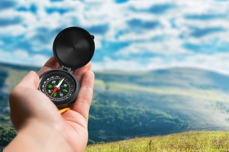 orienteering: Compass, Hiking, Human Hand. Stock Photo