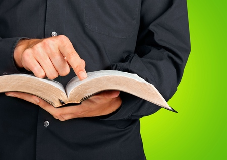 holding bible: Bible, Priest, Preacher.