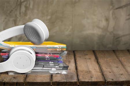 cd case: CD, Headphones, Music.