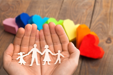 care in the community: Family, Human Hand, Protection.