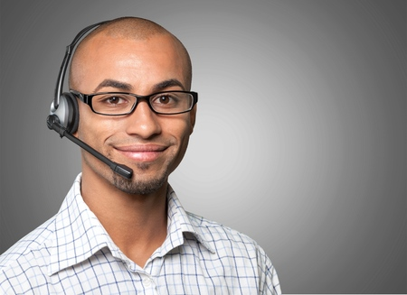 servicio al cliente: Soporte de TI, Hombres, Auriculares. Foto de archivo