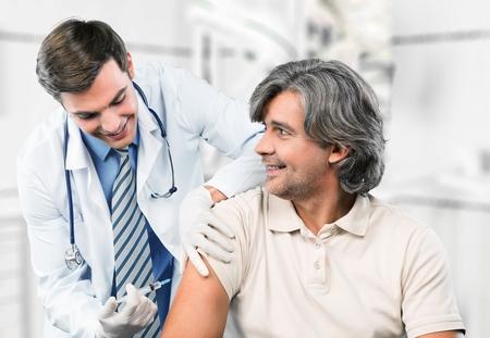 gripe: Inyectar, Vacunación, Gripe. Foto de archivo