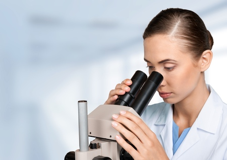 Microscope, Scientist, Medical Research. Stock Photo