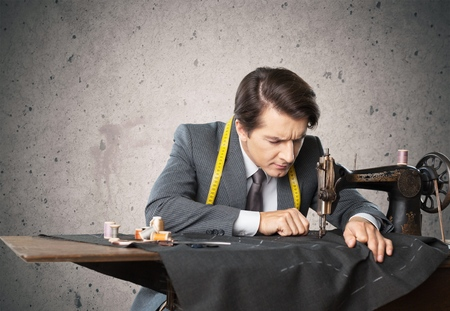 one man: Tailor, skill, handsome. Stock Photo