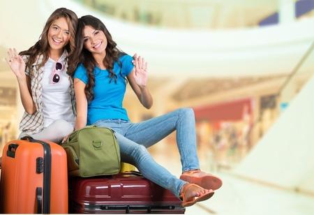 legs crossed at knee: Airport, Travel, Luggage.