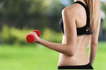 athleticism: Exercising, Gym, Women. Stock Photo