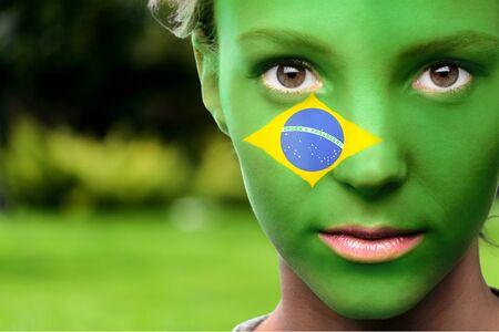 brazilian flag: Human Face, Brazilian Flag, Face Paint. Stock Photo