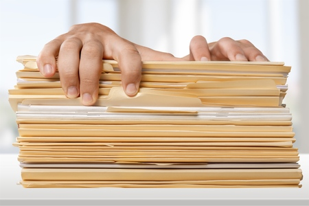 overburdened: Excess, Filing Documents, Working. Stock Photo