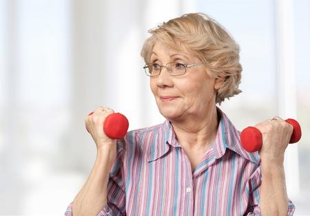 80 plus adult: Senior Adult, Exercising, Relaxation Exercise. Stock Photo
