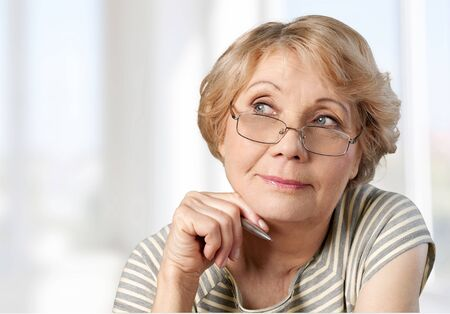 mature adult: Women, Thinking, Mature Adult. Stock Photo