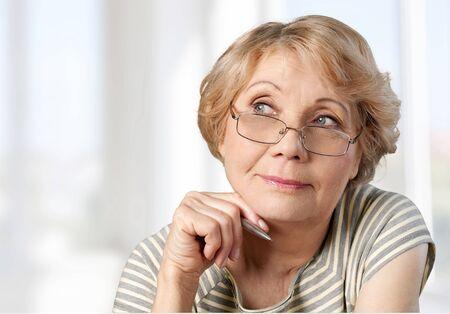mature adult: Women, Thinking, Mature Adult. Stock Photo