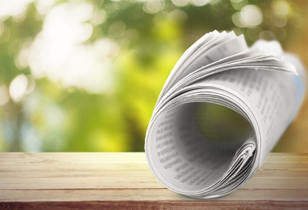 newsworthy: Newspaper, Rolled Up, The Media. Stock Photo