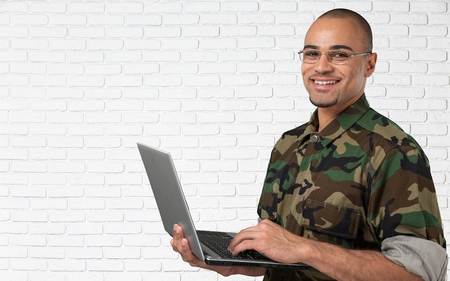 military men: Military, Armed Forces, Laptop. Stock Photo