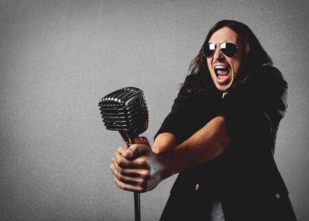 singer with microphone: Singing, singer, male. Stock Photo