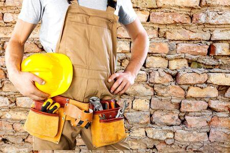 Repairman, closeup, clothing.