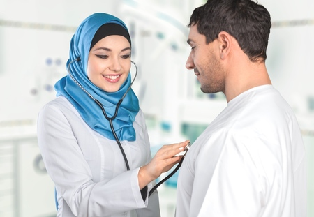 doctor examining woman: Arab, arabic, patient. Stock Photo