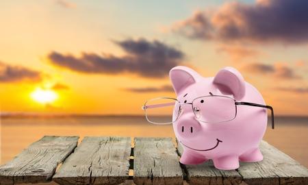 coin bank: Savings, Calculator, Pig. Stock Photo