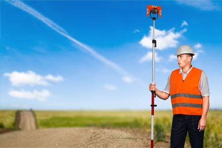 human height: Surveyor, Engineer, Measuring. Stock Photo